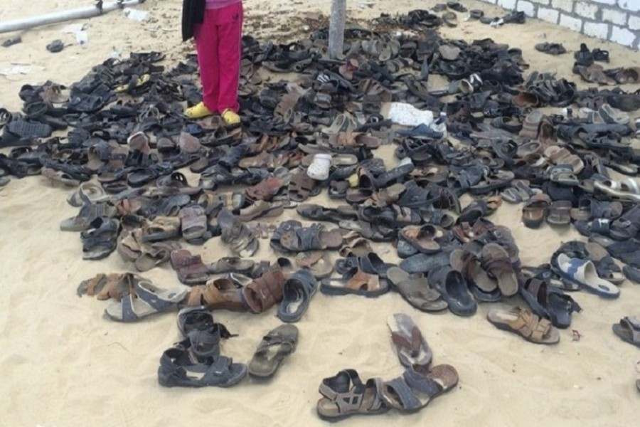 Discarded shoes of victims remain outside Al-Rawda Mosque in Bir al-Abd northern Sinai, Egypt, a day after attackers killed hundreds of worshippers, on Saturday, November 25, 2017. Photo: AP