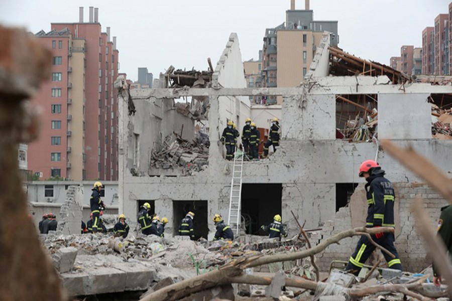 NINGBO: Rescue workers work at the site of a blast in Ningbo of Zhejiang province on Sunday.	— Reuters