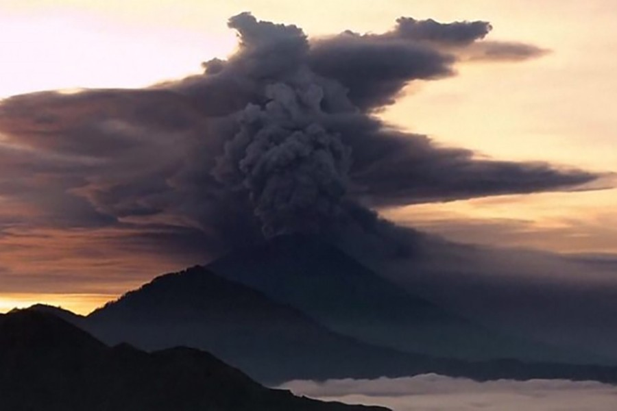 Screenshot taken from a video footage shows ash rising into the sky, disrupting flights. - BBC