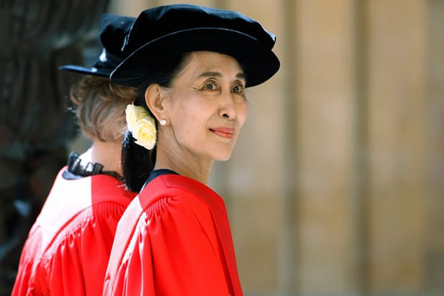 Aung San Suu Kyi in a procession to receive her honorary doctorate from the University of Oxford in 2012. Oxford city council has voted to strip her of her freedom of the city. Photo: AP