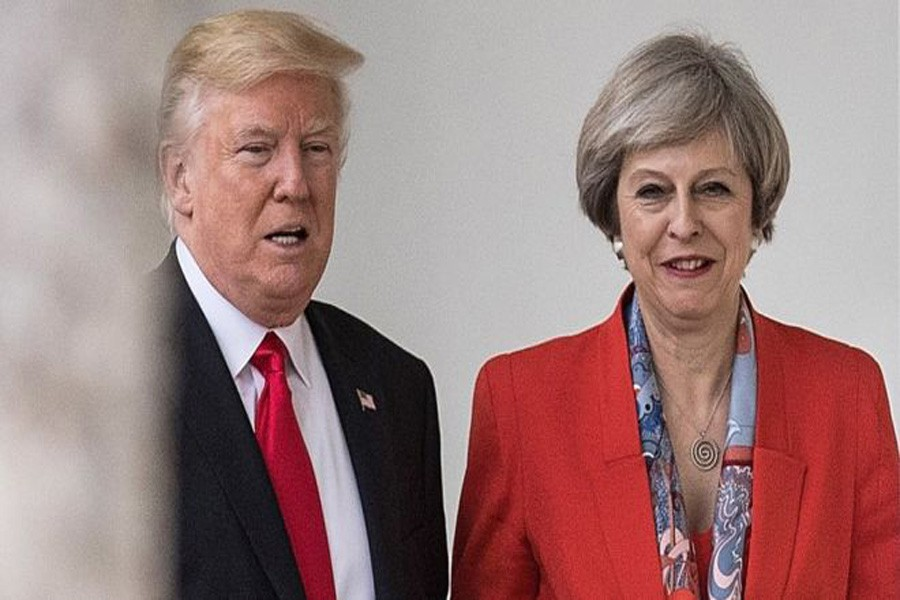 Donald Trump and Theresa May at the White House in January, photo collected