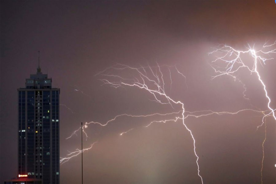 Lightning strikes behind commercial tower near a financial city in Colombo, Sri Lanka. (Reuters Photo)