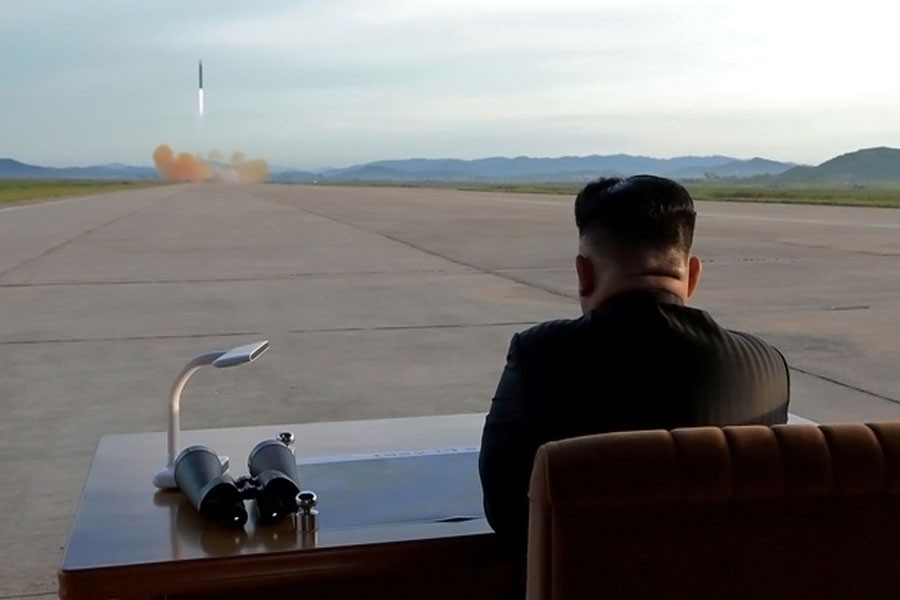 North Korean leader Kim Jong Un watches the launch of a Hwasong-12 missile in this undated photo released by North Korea's Korean Central News Agency (KCNA) on Sept 16, 2017. (Reuters)