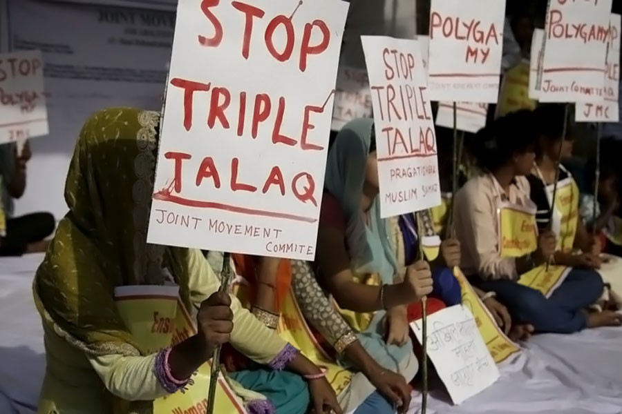 """Activists hold signs during a protest against """"triple talaq,"""" the practice of instant divorce by Muslim men, in New Delhi on May 10. The country's Supreme Court has outlawed this means of ending a marriage. (AP photo)"""