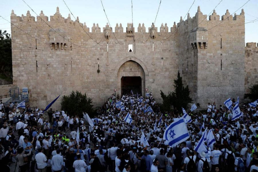 Israelis celebrate they hold Israeli flags during a parade on May 24, 2017 marking Jerusalem Day, the day in the Jewish calendar when Israel captured East Jerusalem and the Old City from Jordan during the 1967 Middle East War. - Reuters file photo