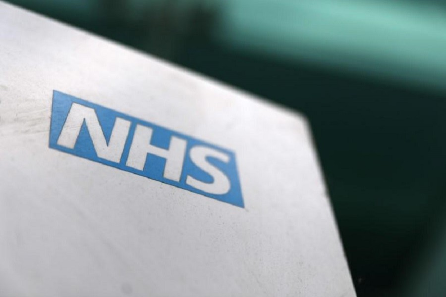 A National Health Services logo is displayed outside a hospital in London, Britain May 14, 2017. Reuters