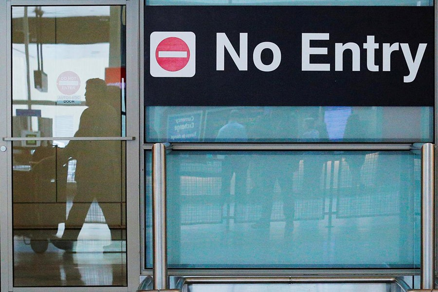 International travellers (reflected in a closed door) arrive at Logan Airport in Boston, Massachusetts, US on June 29 last. - Reuters file photo
