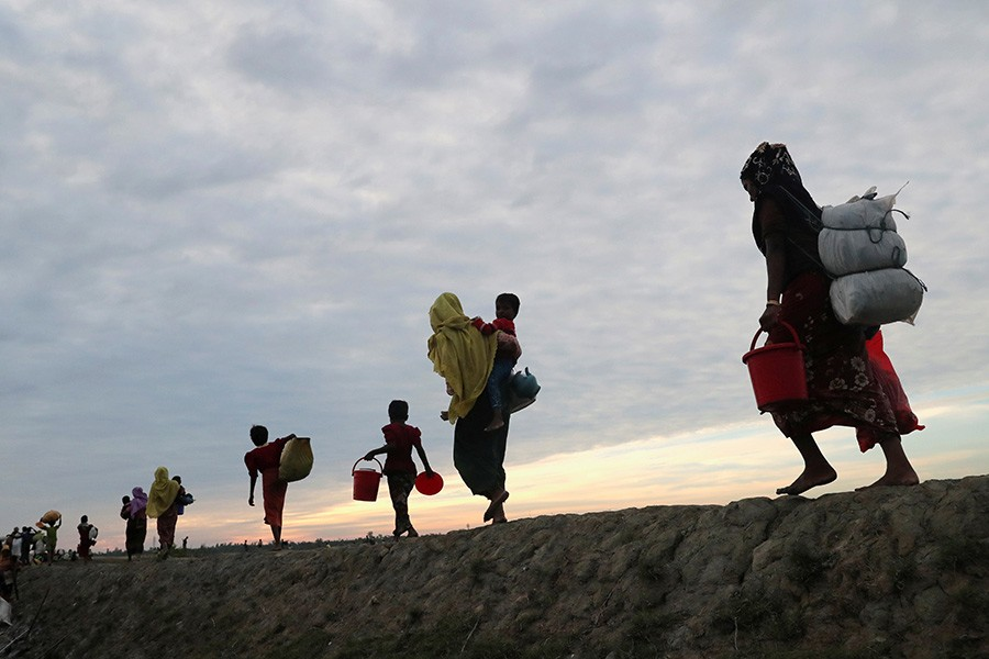 Rohingya refugees walk after crossing the Naf River with an improvised raft to reach to Bangladesh in Teknaf, Bangladesh, November 12 last. - Reuters file photo