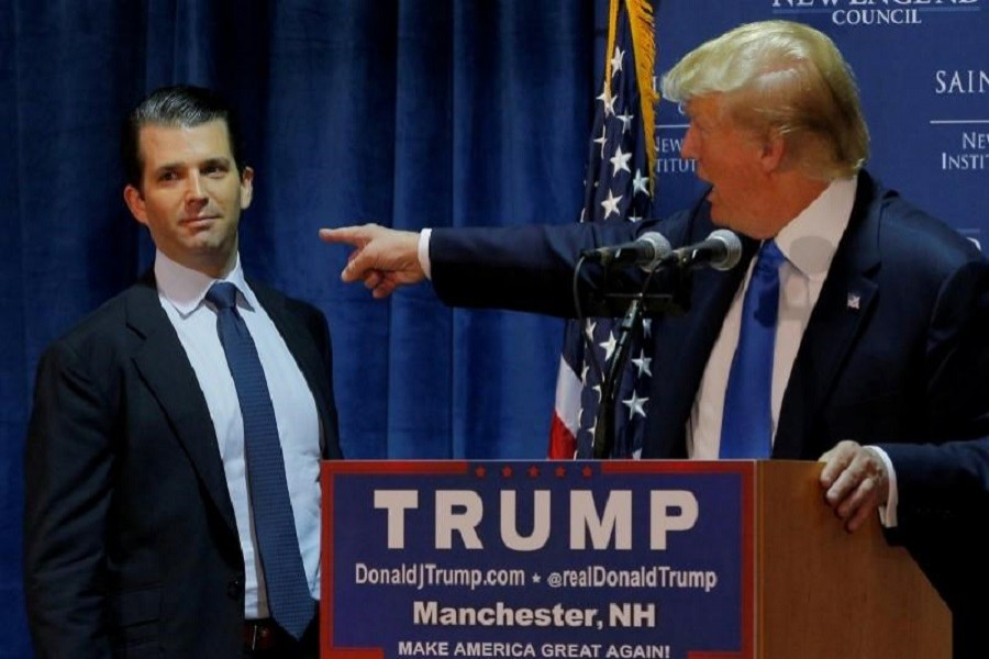Then US Republican presidential candidate Donald Trump (R) welcomes his son Donald Trump Jr. to the stage at an event in Manchester, New Hampshire November 11, 2015. Reuters/File Photo