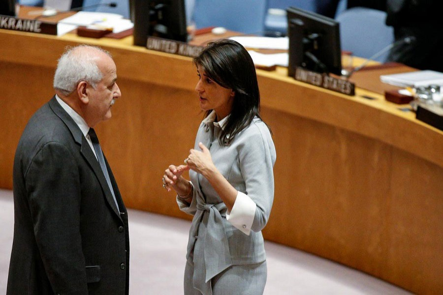 US ambassador to the UN Nikki Haley speaks with Permanent Observer to the State of Palestine to the UN, Riyad Mansour at the UN Headquarters, December 8, 2017. Reuters