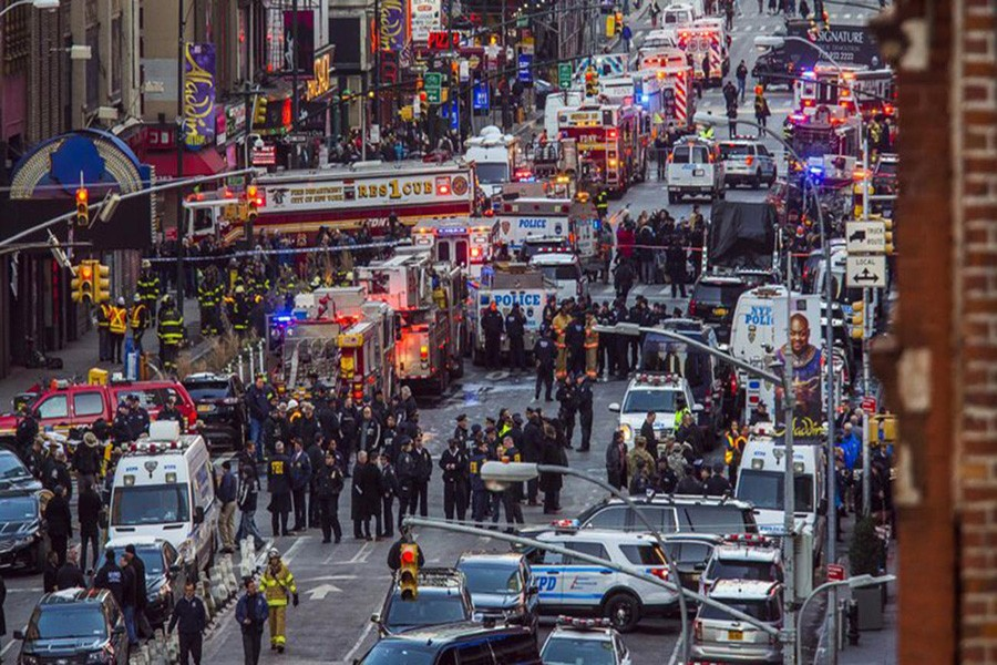 Law enforcement officials work following an explosion near New York's Times Square on Monday, December 11, 2017. Photo: AP