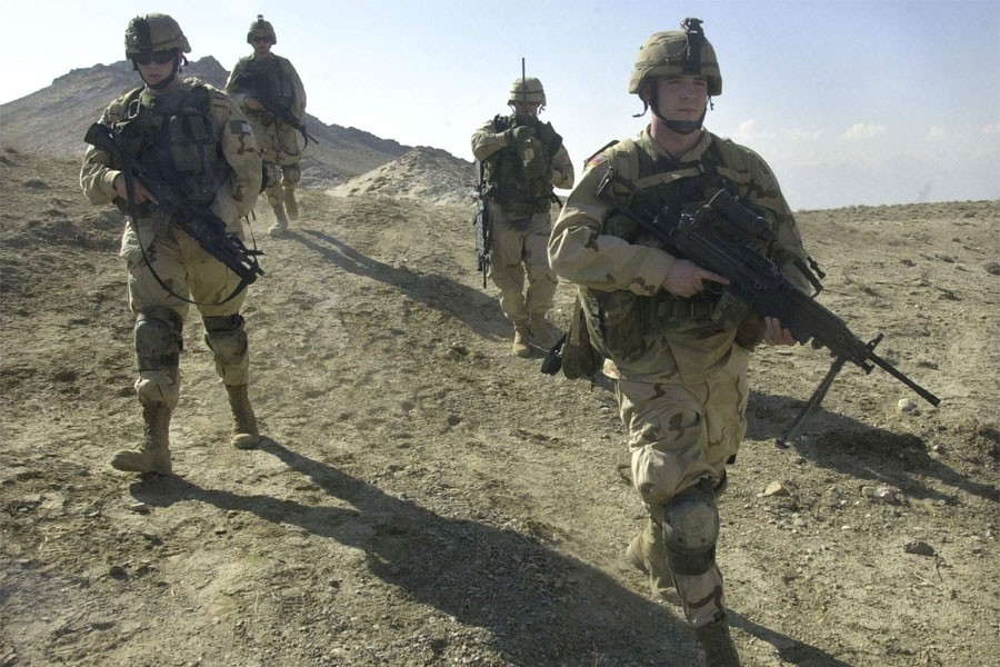 US soldiers patrol the perimeter of a weapons cache four miles of the US military base in Bagram, Afghanistan. (AP Photo)