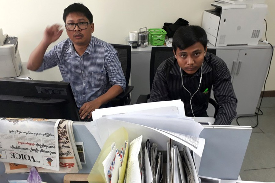 Reuters journalists Wa Lone (L) and Kyaw Soe Oo, who are based in Myanmar, pose for a picture at the Reuters office in Yangon, Myanmar on Monday. - Reuters photo