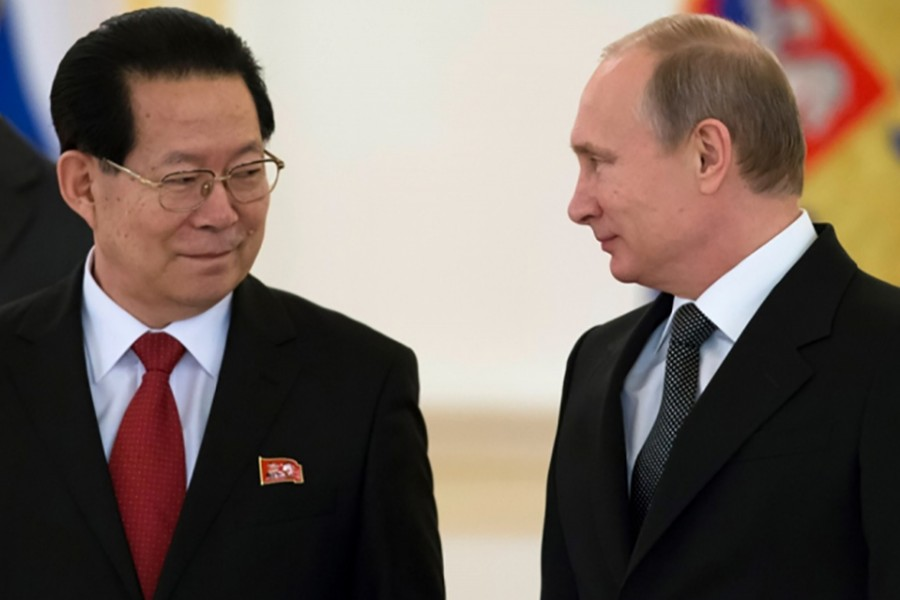 Russian President Vladimir Putin (R) and North Korea's Ambassador Kim Hyun-joon attend a ceremony in Moscow, Russia. - Reuters file photo