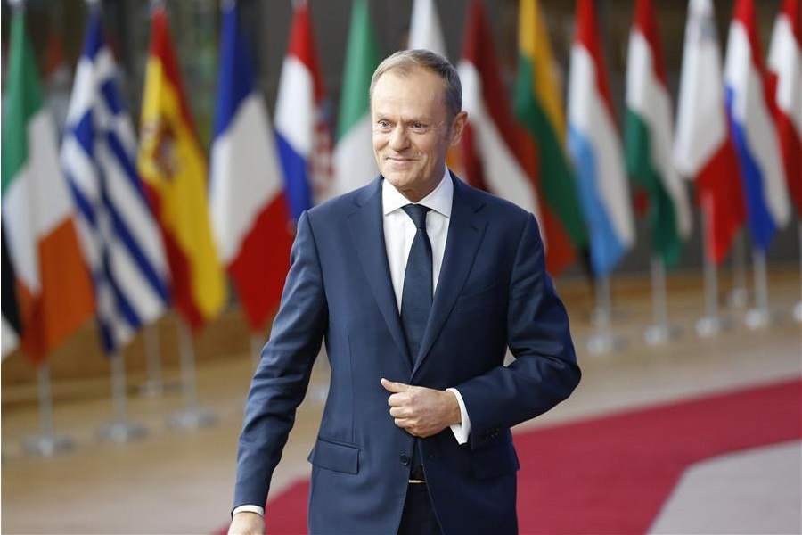 European Council President Donald Tusk arrives at EU headquarters prior to an EU Summit in Brussels, Belgium, Dec. 14, 2017: Xinhua