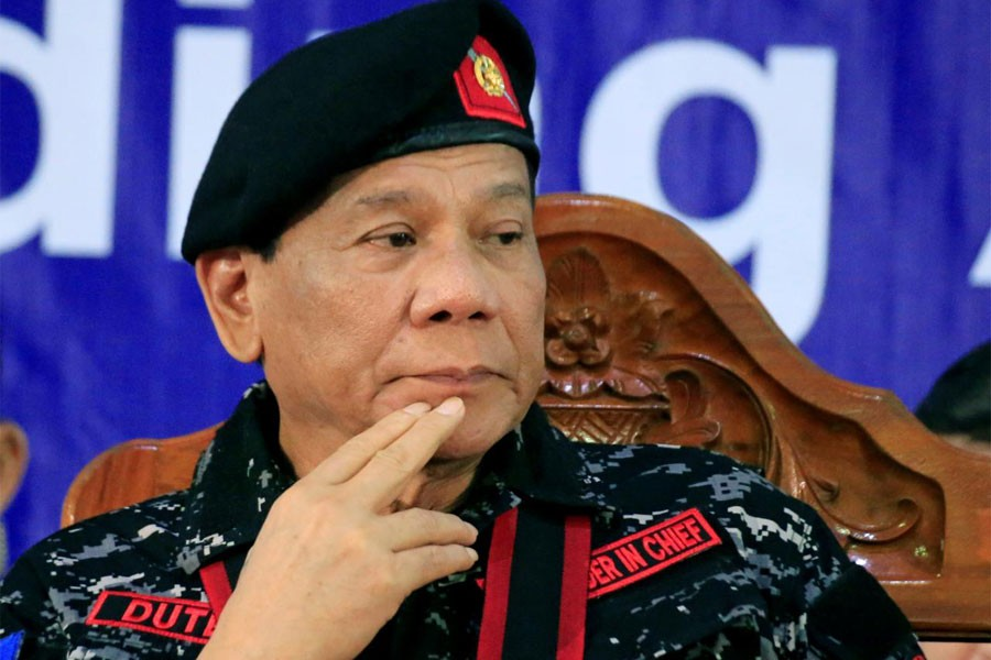 Philippine President Rodrigo Duterte gestures as he attends the 67th founding anniversary of the First Scout Ranger regiment in San Miguel town, Philippines November 24, 2017. (Reuters)