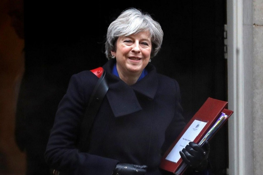 Britain's Prime Minister Theresa May leaves 10 Downing Street in London, Britain, December 20, 2017. Reuters