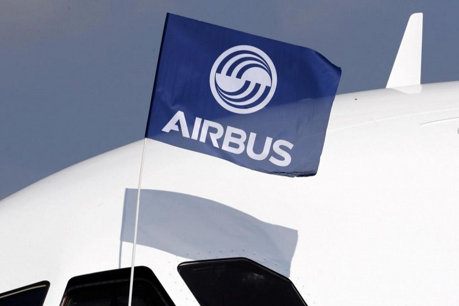 A flight test engineer holds an Airbus Group flag after the first flight of the Airbus A320neo (New Engine Option) in Colomiers near Toulouse, southwestern France, September 25, 2014. Reuters