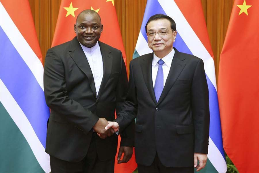 Chinese Premier Li Keqiang (R) meets with visiting Gambian President Adama Barrow in Beijing, capital of China, Dec. 22, 2017. Xinhua.