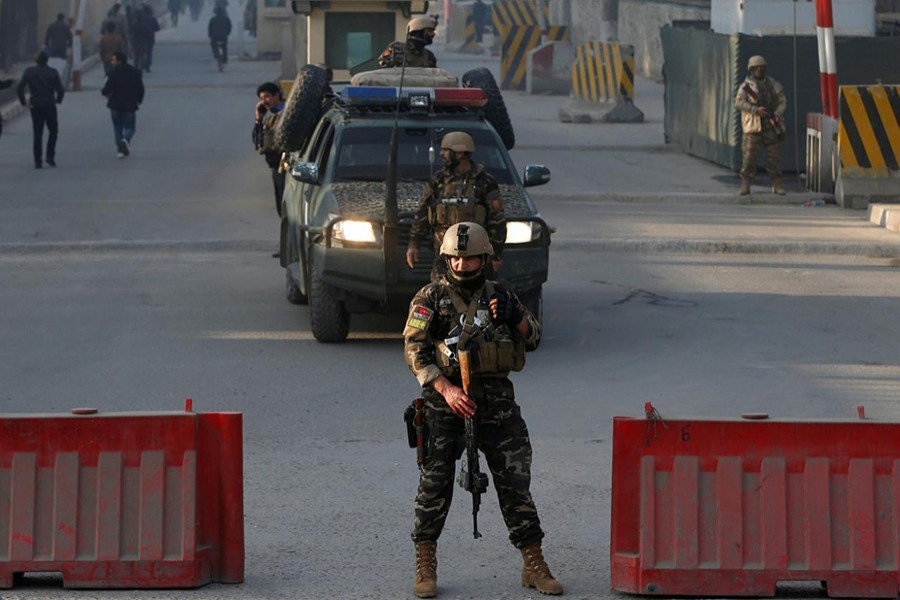 Afghan security forces keep watch at a check point close to the compound of Afghanistan's national intelligence agency in Kabul, Afghanistan on Monday. - Reuters photo