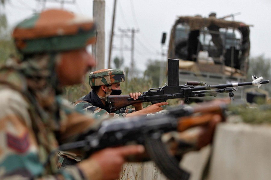 Security personnel take position at an encounter site in Kashmir, India. - Reuters file photo