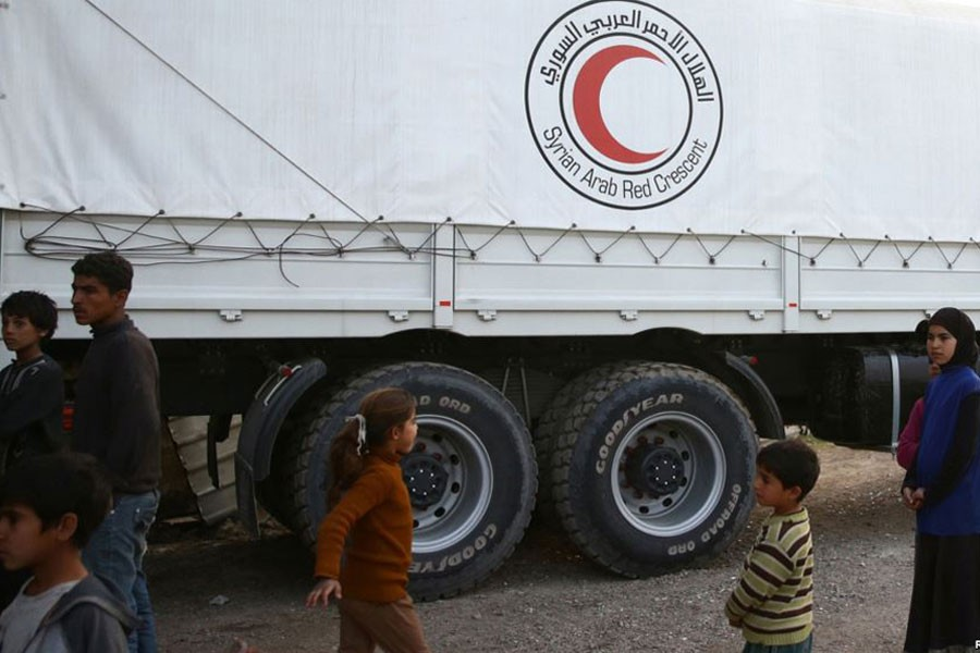 People stand next to Syrian Arab Red Crescent truck in the town of Nashabiyeh, eastern Ghouta in Syria, Nov. 28, 2017. (Picture used for representational purpose)