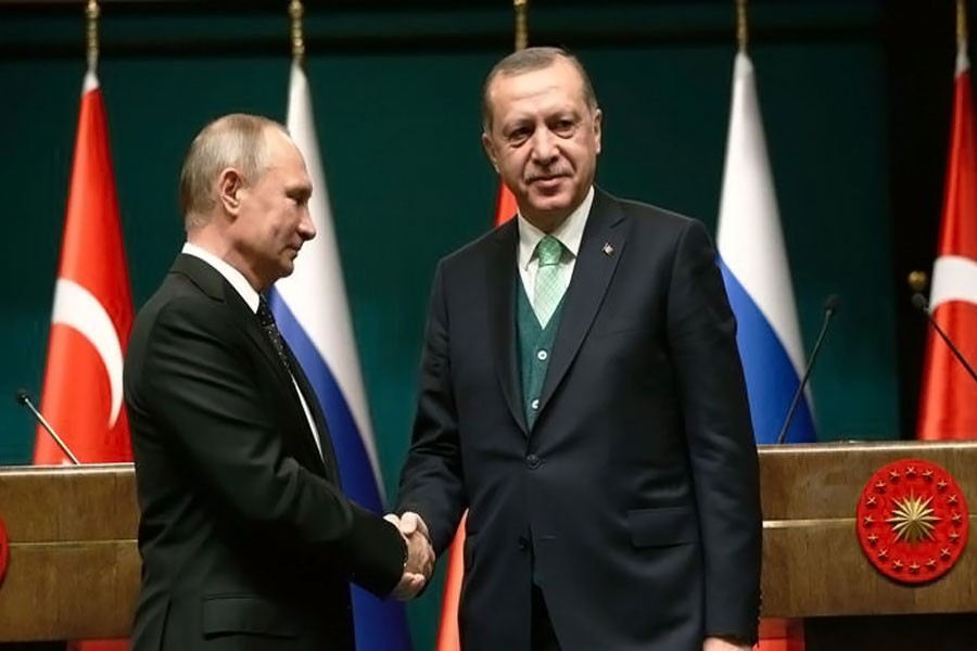 Turkey's President Recep Tayyip Erdogan, right, shakes hands with Russia's President Vladimir Putin following their joint news statement after their meeting at the Presidential Palace in Ankara, Turkey, on Dec 11. (Associated Press)