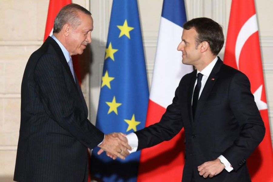 French President Emmanuel Macron (R) and Turkish President Recep Tayyip Erdogan shake hands after a joint press conference at the Elysee Palace in Paris. (Reuters)