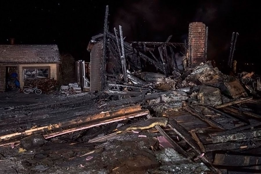 The remains of a house destroyed in an early morning fire are seen in Pubnico Head, Nova Scotia on Sunday, Jan 7, 2018. (Internet photo)