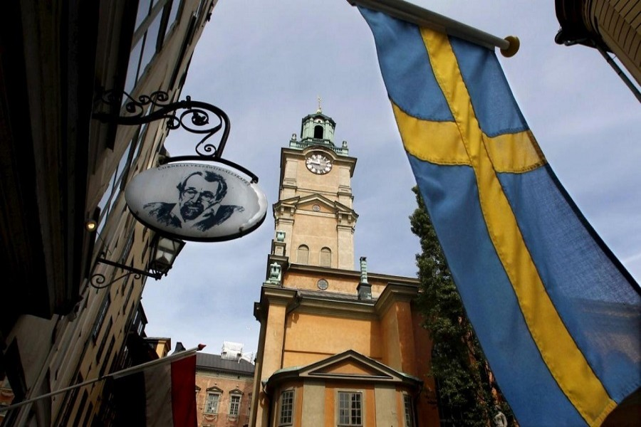 Sweden's flag waves near the Stockholm Cathedral in Gamla Stan or the Old Town district of Stockholm, Sweden, in this June 9, 2010 file photo. Reuters