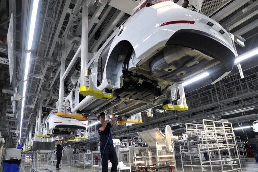 Workers work at a car general assembly line in Cangzhou, north China's Hebei Province, September 12, 2017. Xinhua/File Photo