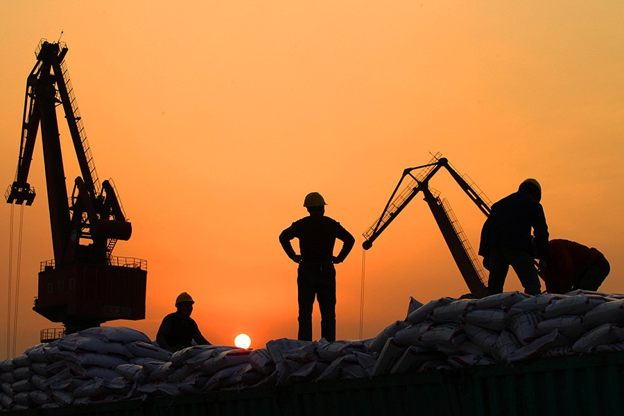 Workers load imported goods at a port in Nantong, Jiangsu province in China. - Reuters file photo