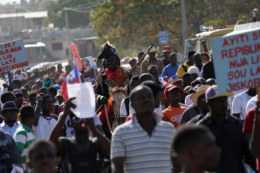 Protesters march during a protest against reported comments made by US President Donald Trump about Haiti, in the streets of Port-au-Prince, Haiti on Monday. - Reuters photo