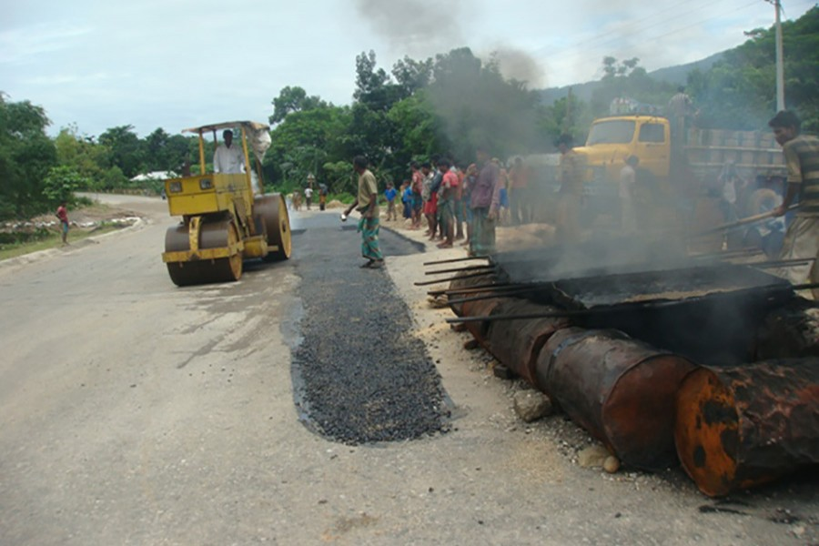 Workers carrying out maintenance work on Sylhet-Tamabil-Jaflong road under Sylhet Road Division. - RHD file photo