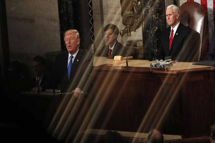 Vice President Mike Pence watches as US President Donald Trump delivers his State of the Union address to a joint session of the US Congress on Capitol Hill in Washington, US January 30, 2018. Photo: Reuters