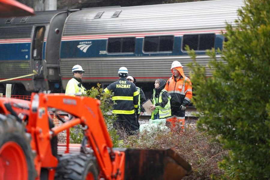 Emergency responders are at the scene after an Amtrak passenger train collided with a freight train and derailed in Cayce, South Carolina, US, February 4, 2018. (REUTERS)