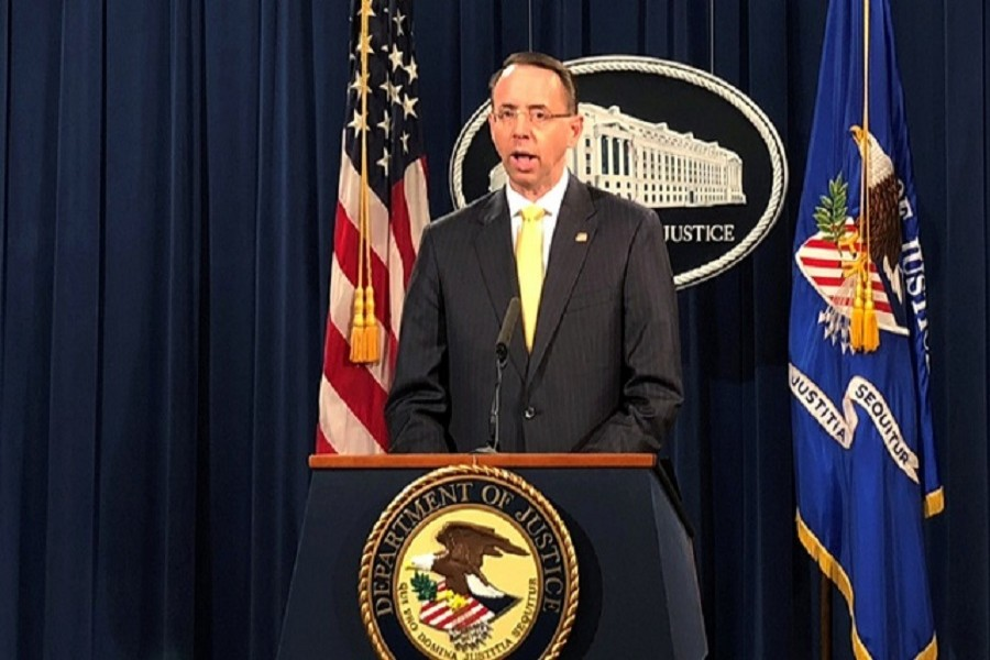 Deputy US Attorney General Rod Rosenstein announces the indictments of more than a dozen Russians charged with conspiring to interfere in the 2016 US election campaign during a news conference at the Justice Department in Washington, US, February 16, 2018. Reuters