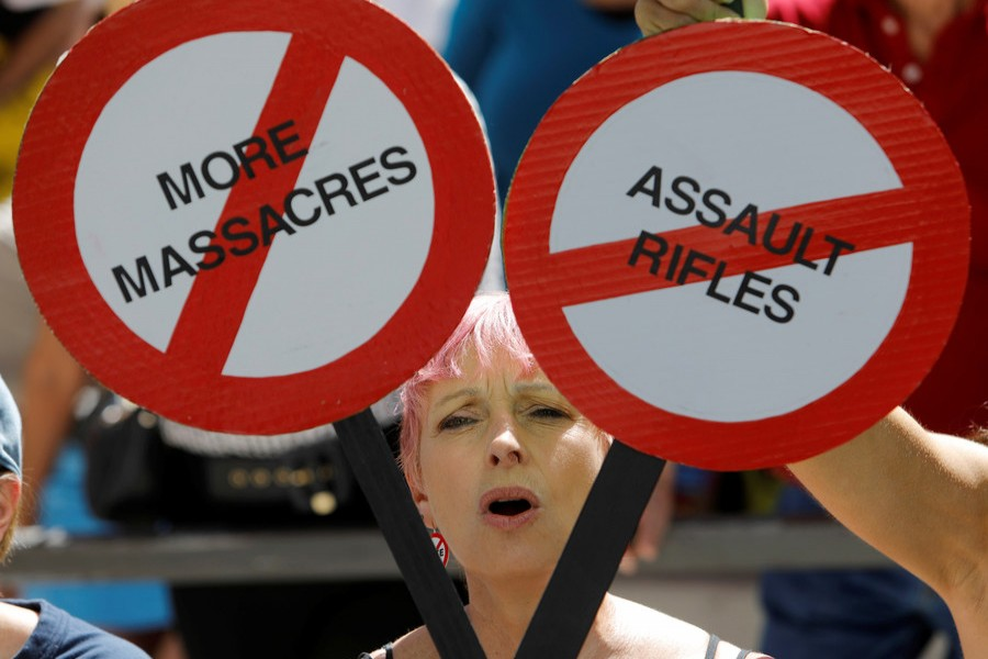 A protester is framed by signs calling for more gun control three days after the shooting at Marjory Stoneman Douglas High School, at a rally in Fort Lauderdale, Florida, US on Saturday. - Reuters photo