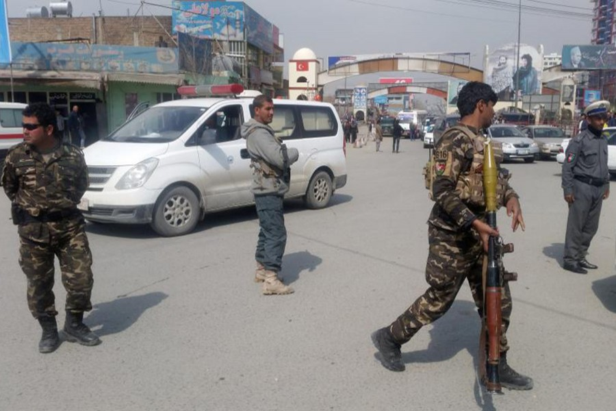 Afghan security forces keep watch near the site of a blast in Kabul, Afghanistan on Friday. - Reuters photo