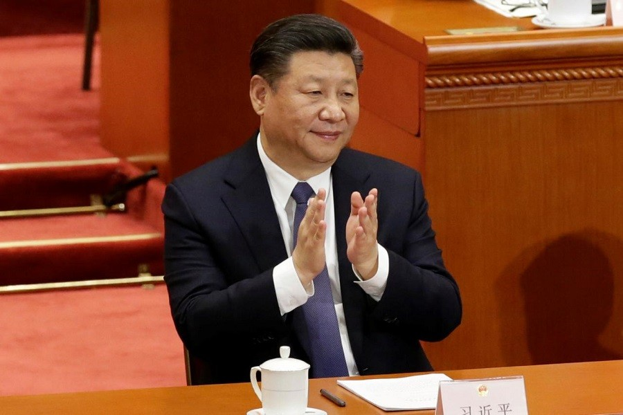 Chinese President Xi Jinping applauds after the parliament passed a constitutional amendment lifting presidential term limit, at the third plenary session of the National People's Congress (NPC) at the Great Hall of the People in Beijing, China March 11, 2018. Reuters