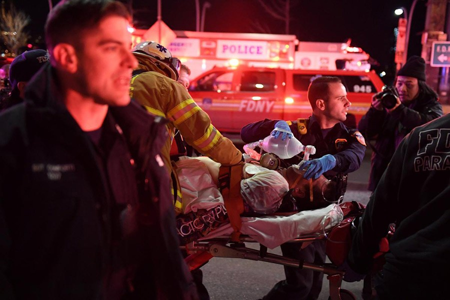 Paramedics and members of the NYFD seen performing CPR on a victim of a helicopter crash in New York, US on Sunday. The victim, however, later died in hospital. - Reuters photo