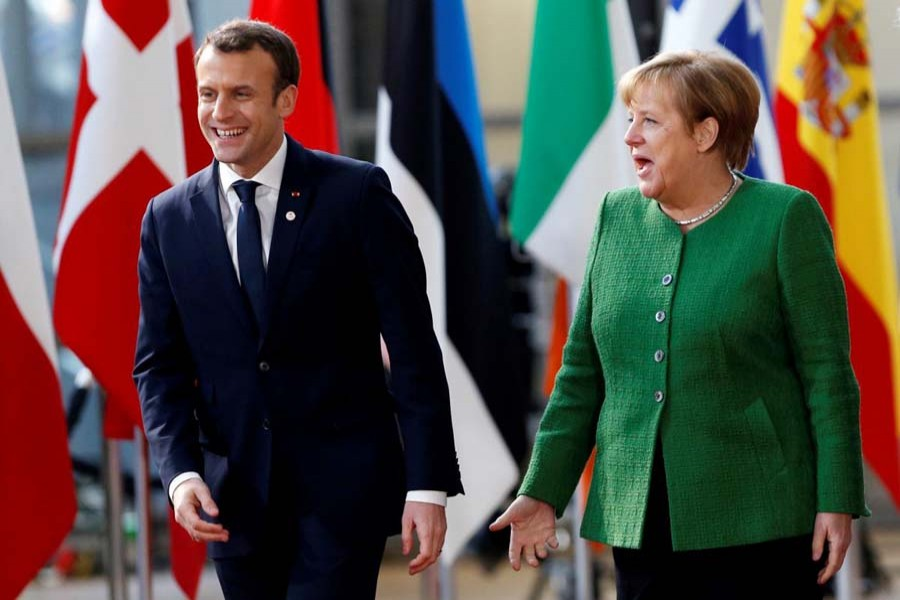 French President Emmanuel Macron and German Chancellor Angela Merkel at the European Council headquarters in Brussels on Feb 23. Reuters/File Photo