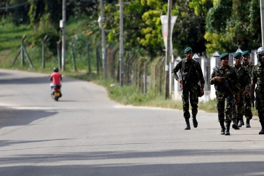 Sri Lanka Special Task Force soldiers patrol along a road after a clash between two communities in Digana, central district of Kandy, Sri Lanka March 8, 2018. Reuters/Files