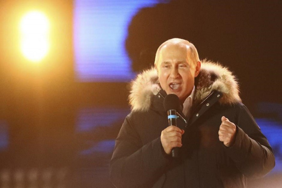 Russian President and Presidential candidate Vladimir Putin delivers a speech during a rally and concert marking the fourth anniversary of Russia's annexation of the Crimea region, at Manezhnaya Square in central Moscow, Russia March 18, 2018. Reuters