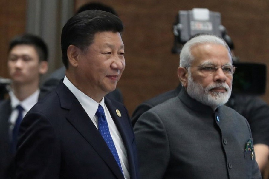 Chinese President Xi Jinping (L) and Indian Prime Minister Narendra Modi, arrive for the 'Dialogue of Emerging Market and Developing Countries' on the sidelines of the 2017 BRICS Summit in Xiamen, Fujian province, China, 05 September 2017. Reuters/Files