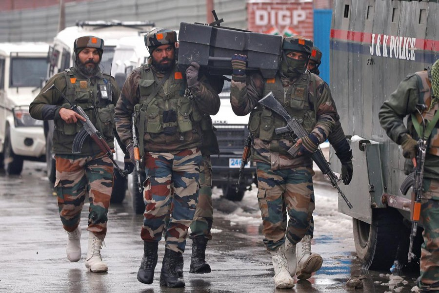 Indian army soldiers carry a box containing bulletproof shields near the site of a gunbattle with suspected militants in Srinagar February 12. Reuters/File Photo