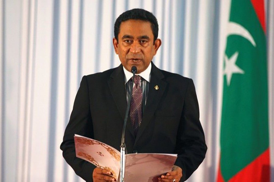 Abdulla Yameen takes his oath as the President of Maldives during a swearing-in ceremony at the parliament in Male on November 17, 2013 - Reuters/File