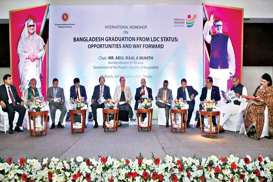 Finance Minister A M A Muhith speaking at an international workshop on 'Bangladesh Graduation from LDC Status: Opportunities and Way Forward' at a city hotel on Friday — FE Photo