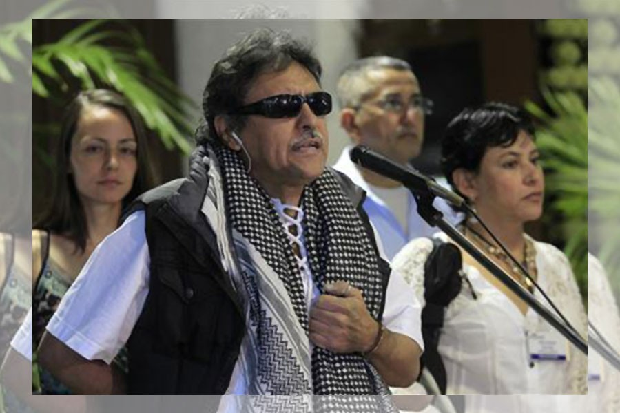 Revolutionary Armed Forces of Colombia (FARC) negotiator Jesus Santrich speaks to the media before the start of talks in Havana March 11, 2013. Reuters.