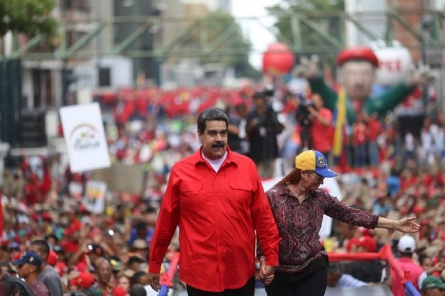 Venezuela's President Nicolas Maduro and his wife Cilia Flores attend a rally with supporters in Caracas, Venezuela April 14, 2018. Reuters